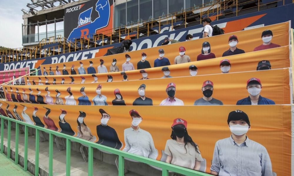 Cardboard baseball, soccer fans fill stadiums to root on their teams – CNET