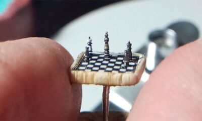 Sculptor creates the world's tiniest chess set, the size of a thumbtack