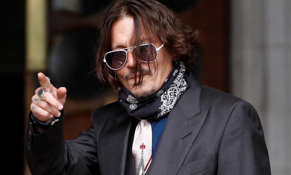 Actor Depp denies slapping ex-wife in row over 'Wino forever' tattoo – Reuters