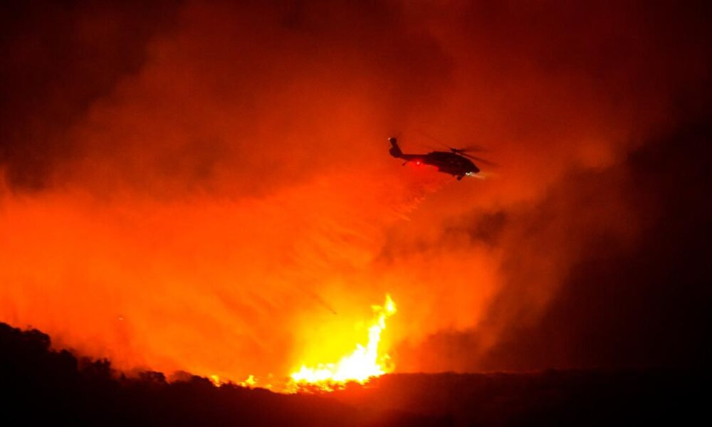 Wildfires have scorched about 100,000 acres in 3 states