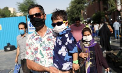 Iran's coronavirus death toll exceeds 21,000: health ministry – Reuters